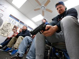 Jaden Adams person look over a unloaded semi automatic handgun during a class to obtain the Utah concealed gun carry permit, at Range Master of Utah, on January 9, 2016 in Springville, Utah. Utahs permits, available for a fee to non-residents who meet certain requirements, are among the most popular in the country because they are recognized in more than 30 states.