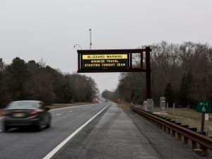 A sign warns drivers of blizzard conditions on the north bound Garden State Parkway on January 22, 2016 in Cape May County, New Jersey.