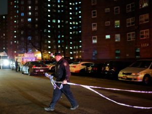 A New York Police officer demarcates a crime scene in the Bronx.