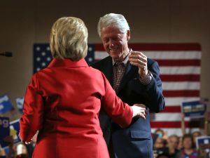 Democratic presidential candidate former Secretary of State Hillary Clinton embraces her husband former U.S. president Bill Clinton during a caucus day event at Caesers Palace on February 20, 2016 in Las Vegas, Nevada. Hillary Clinton defeated Democratic rival U.S.Sen Bernie Sanders in the Nevada Democratic caucuses.
