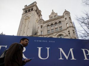 A Trump sign is seen near the Old Post Office Building in Washington, DC, on March 10, 2016 which will become Trump International Hotel Washington. Donald Trump's race for the White House has sown panic among Republican leaders scrambling to prevent a man billed as a demagogue from clinching the party nomination. / AFP / Andrew Caballero-Reynolds