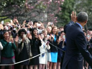 US President Barack Obama wave to a crowd as he walks toward Marine One ,while departing the White House, March 11, 2016 in Washington, DC. President Obama is traveling to Austin, Texas to attend the South by SouthwestÊfestival.