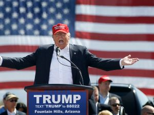 FOUNTAIN HILLS, AZ - MARCH 19: Republican presidential candidate Donald Trump speaks to guest gathered at Fountain Park during a campaign rally on March 19, 2016 in Fountain Hills, Arizona. Trumps visit to Arizona is the second time in three months as he looks to gain the GOP nomination for President. (Photo by Ralph Freso/Getty Images)