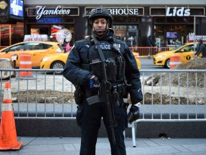 A New York Police Department (NYPD) officer patrols in Times Square on March 22, 2016, in New York.