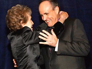Former New York Mayor Rudy Giuliani (R) is presented the Ronald Reagan Freedom Award by former First Lady Nancy Reagan during a mock ceremony before a dinner in his honor in Beverly Hills, 08 March 2002.