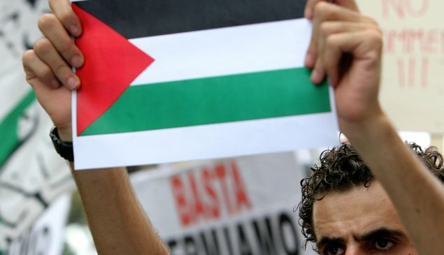 A demonstrator holding a Palestinian flag protests during a rally in Rome 27 July 2006, to show solidarity with the Lebanese and Palestinian people. Many countries around the world have been witnessing anti-Israeli demonstrations since the Israeli offensive began against Lebanon sixteen days ago.