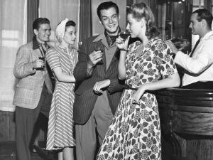 UNITED STATES - CIRCA 1950s: Socializing at a bar.