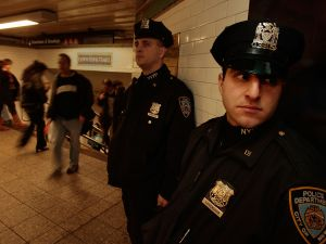 Heightened security on NYC subways due to the terrorist attacks in Brussels.