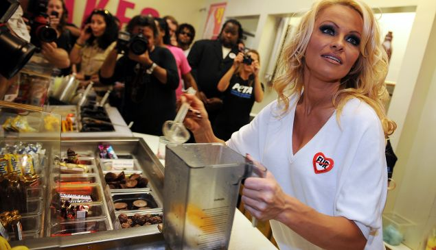 Pamela Anderson creates the first all-vegan shake at Millions of Milkshakes in West Hollywood, California in 2010.