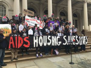 HIV/AIDS advocates rallying outside City Hall.
