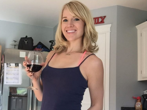 April Storey, working out with wine