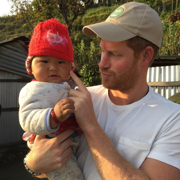 Prince Harry's Nepal Trip Featured Babies, Dogs and Philanthropic Pursuits
