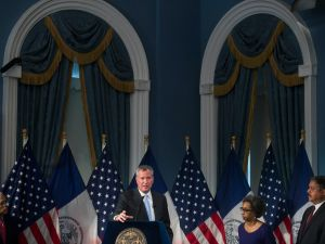 Mayor Bill de Blasio, center, speaks about the budget of the city's public hospitals.