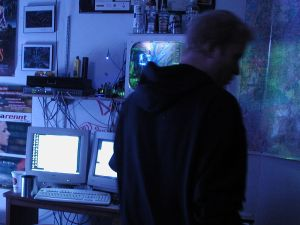 A hacker in his office, from Wikipedia.