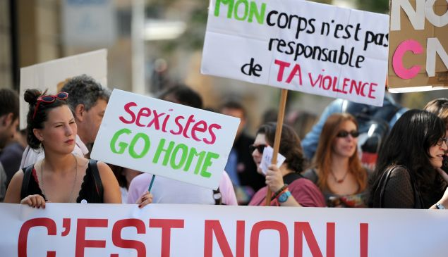 """People march through the city taking part in a """"Slut Walk"""" on October 6, 2012 in Aix-en-Provence, southern France."""