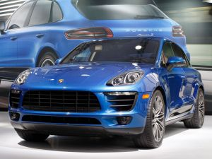 A Porsche Macan S is shown during media preview days at the 2013 Los Angeles Auto Show on November 20, 2013 in Los Angeles, California. The LA Auto Show was founded in 1907 and is one of the largest with more than 20 world debuts expected. The show will be open to the public November 22 through December 1.