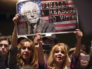 Supporters of Democratic presidential candidate Bernie Sanders attend a campaign rally, March 23, 2016 at the Wiltern Theater in Los Angeles, California.
