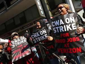 NEW YORK, NEW YORK - APRIL 13: Hundreds of Verizon workers strike outside of the telecommunications company's Brooklyn offices on April 13, 2016 in New York City. Across the nation nearly 40,000 Verizon workers with the Communications Workers of America (CWA) and the International Brotherhood of Electrical Workers (IBEW) walked off their jobs Wednesday demanding a new contract. The workers' contract expired in August, and Verizon management has yet to negotiate a new one citing issues with health care expenses for its retired and current employees.