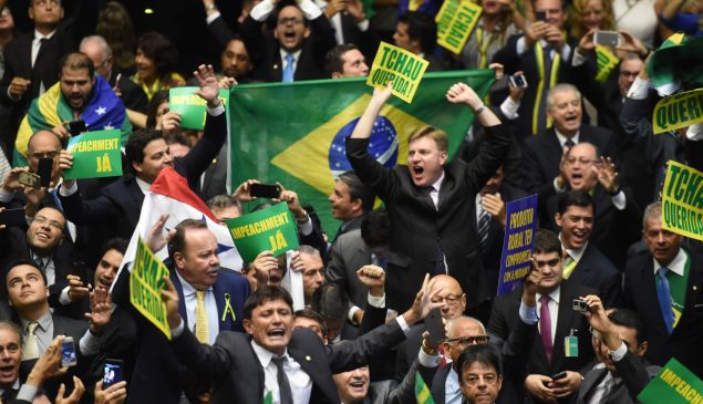 Brazil's lawmakers celebrate after they reached the votes needed to authorize President Dilma Rousseff's impeachment to go ahead, at the Congress in Brasilia on April 17, 2016.