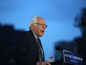 Democratic Presidential candidate Bernie Sanders speaks at a campaign rally on the eve of the New York primary, April 18, 2016 in the Queens borough of New York City. While Sanders is still behind in the delegate count with Hillary Clinton, he has energized many young and liberal voters around the country. New York holds its primary this Tuesday.