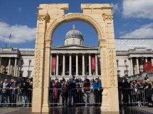 A replica of Palmyra's Arch of Triumph with the National Portrait Gallery framed behind is unveiled in Trafalgar Square, central London, on 19 April 2016. The original arch was destroyed by the Islamic State (IS) and the replica has been crafted using the latest 3D printing and carving technologies by the Institute for Digital Archaeology.