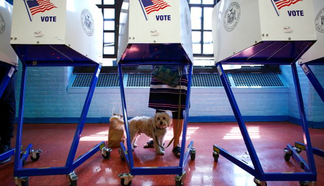 A woman casts vote at a polling station in Brooklyn, New York during the New York presidential primary.
