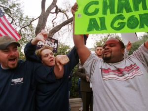 """381733 07: Victor Reed, right, a pro-Gore supporter, is yelled at by pro-Bush supporters outside the Texas governor's mansion November 11, 2000, in Austin, Texas. Bush, spending the weekend at his ranch, complained about the state of the presidential election being in """"limbo."""""""