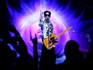 "LOS ANGELES, CA - MARCH 28: ***EXCLUSIVE*** Musician Prince performs his first of three shows onstage during ""One Night... Three Venues"" hosted by Prince and Lotusflow3r.com held at NOKIA Theatre L.A. LIVE on March 28, 2009 in Los Angeles, California."