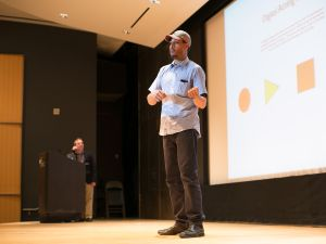 Computer programmer and aspiring actor Ian Ingram presents during the Broadway Hackathon at the New York Public Library for the Performing Arts. In the background is library director Doug Reside.