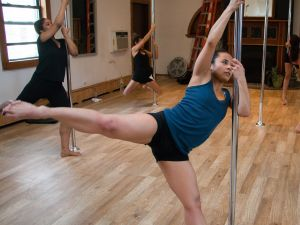 Students build strength and confidence through pole dancing