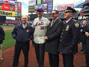 Police Commissioner Bill Bratton, Mayor Bill de Blasio, Fire Commissioner Daniel Nigro, and Chief of Department James O'Neill.