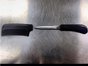 A knife concealed in a comb.