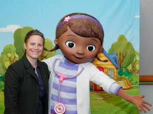 Doc McStuffins creator Chris Nee with Doc herself.