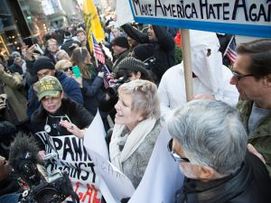 Fighting erupts between pro and anti Trump supporters outside the Trump Towers on 5th Avenue New York.