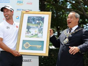 GOLD COAST, AUSTRALIA - NOVEMBER 06: Gold Coast Mayor Tom Tate presents Adam Scott of Australia the Key to the City at Royal Pines Resort on November 6, 2013 on the Gold Coast, Australia.