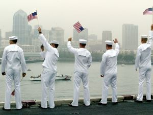 U.S. sailors wave as they return home June 2, 2003 in Coronado, California.