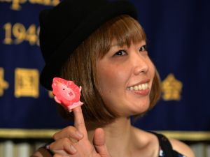 "Japanese artist Megumi Igarashi with one of her ""Manko-chan"" sculptures."
