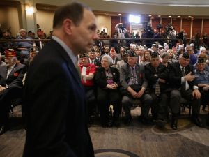 U.S. Veterans Affairs Secretary Robert McDonald walks past members of the American Legion before addressing their annual conference this February in Washington, DC.