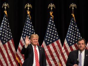 Republican presidential candidate Donald Trump (L) greets the crowd during a campaign rally with New Jersey Gov. Chris Christie, right, at Lenoir-Rhyne University March 14, 2016 in Hickory, North Carolina.