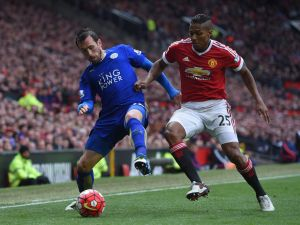 Christian Fuchs of Leicester City holds off Antonio Valencia of Manchester United during the Barclays Premier League match between Manchester United and Leicester City at Old Trafford on May 1, 2016 in Manchester, England.