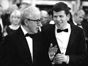 "Woody Allen talks with Jesse Eisenberg as they arrive for the screening of the film ""Cafe Society"" during the opening ceremony of the 69th Cannes Film Festival."