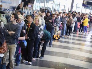 Passengers at O'Hare International Airport wait in line to be screened at a Transportation Security Administration (TSA) checkpoint on May 16, 2016 in Chicago, Illinois.