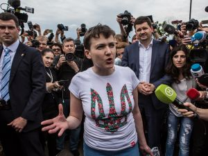 Ukrainian military pilot Nadiya Savchenko is surrounded by media upon her arrival at Kyiv Boryspil Airport on May 25, 2016 in Boryspil, Ukraine. Savchenko was captured while fighting Russia-backed rebels in eastern Ukraine and put on trial in Russia on charges she was complicit in the deaths of two Russian journalists. In March she was convicted and sentenced to 22 years in prison, but was reportedly swapped for two Russian fighters captured by Ukrainian forces.