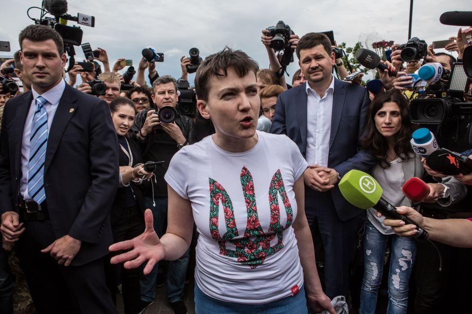 Freed Ukrainian Pilot Curses at Putin and Walks in Public Fountain