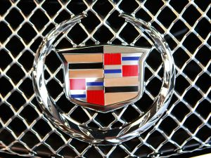 A Cadillac emblem decorates the grill of an Escalade offered for sale at Grossinger's GM dealership May 13, 2009 in Lincolnwood, Illinois. In an attempt to shore up the industry General Motors announced plans to cut 2600 dealerships while Chrysler has made plans to eliminate about 850.