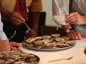 Judges for the annual British Oyster Opening Championship deliberate over a competitor's tray. (Photo by Oli Scarff/Getty Images)