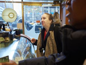 Gale Brewer ordering her first coffee of the day after a morning meeting on 7th Avenue.