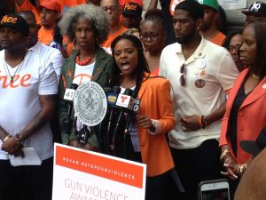 Tamika Mallory, center, in front of Councilman Jumaane Williams and beside Councilwoman Vanessa Gibson, right.