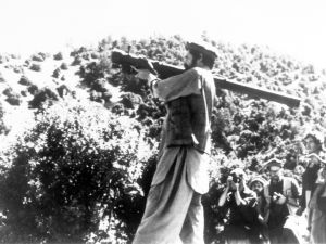 An Afghan Mujahideen demonstrates positioning of a hand-held surface-to-air missile.