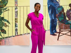 Njideka Akunyili Crosby in front of her work.